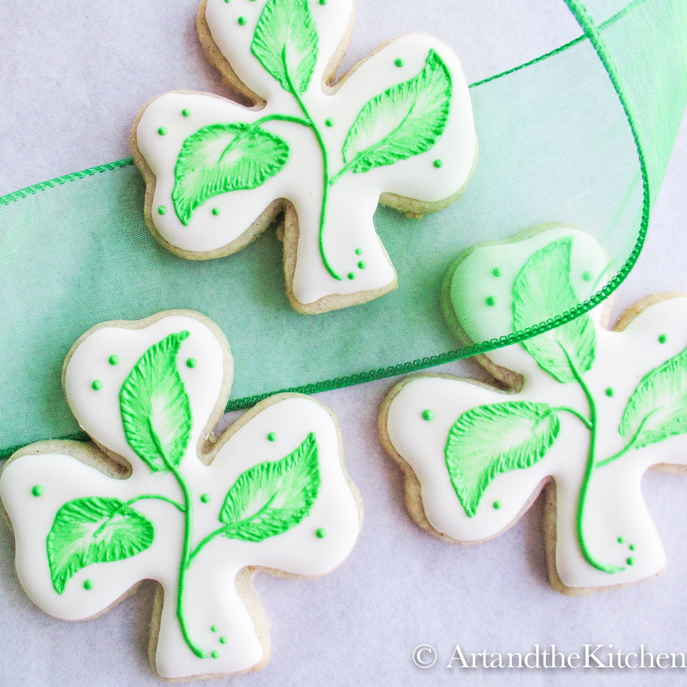 Shamrock cookies with brush embroidery technique