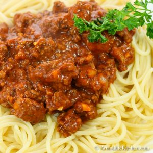 spaghetti topped with chunky meaty sauce