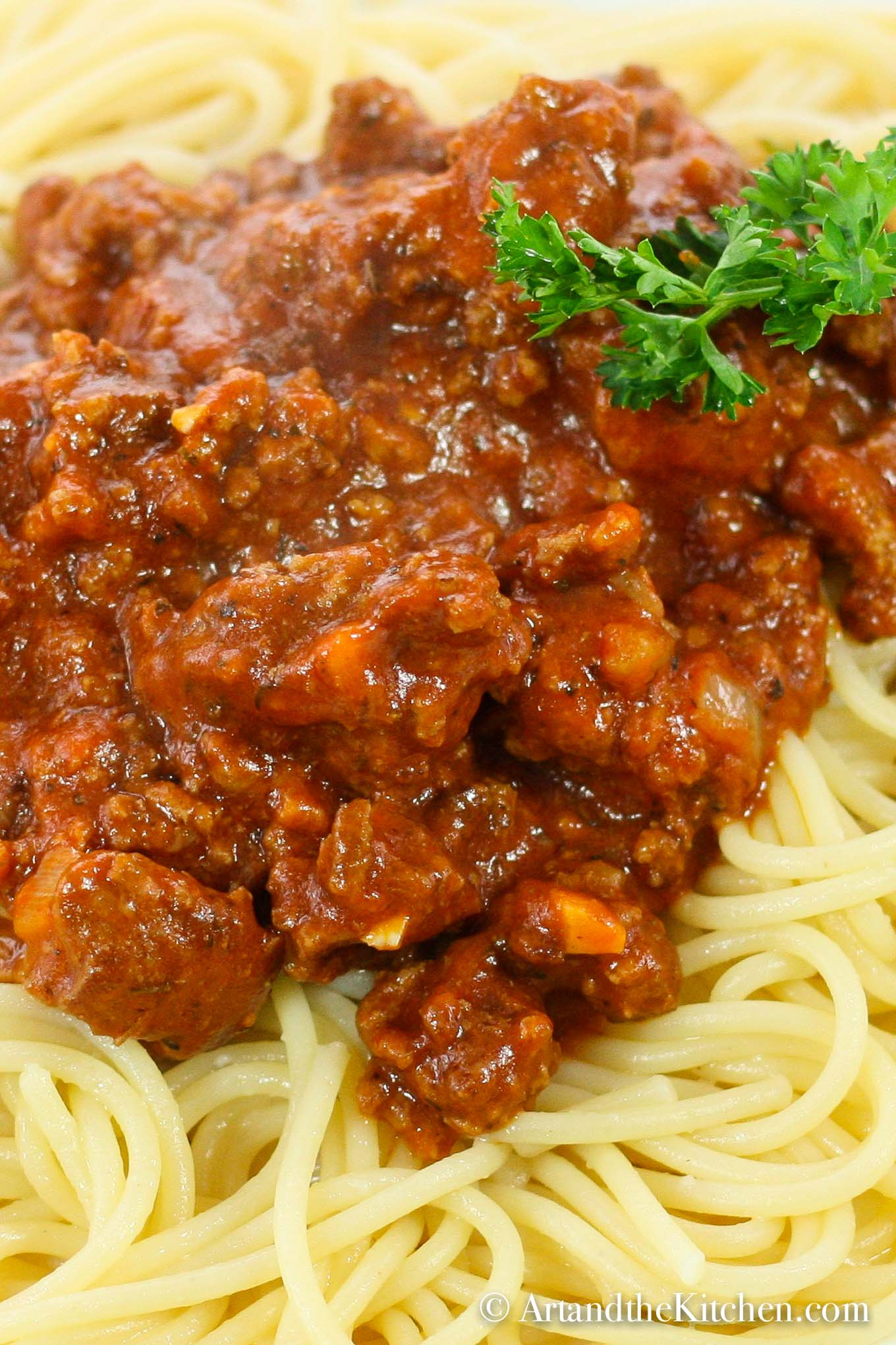 thick meat sauce on top of spaghetti pasta