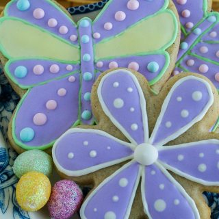 Flower and butterfly shaped sugar cookies decorated with colourful royal icing.