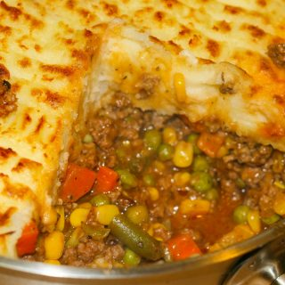 shepherd's pie baked with ground beef, vegetables topped with mashed potatoes.