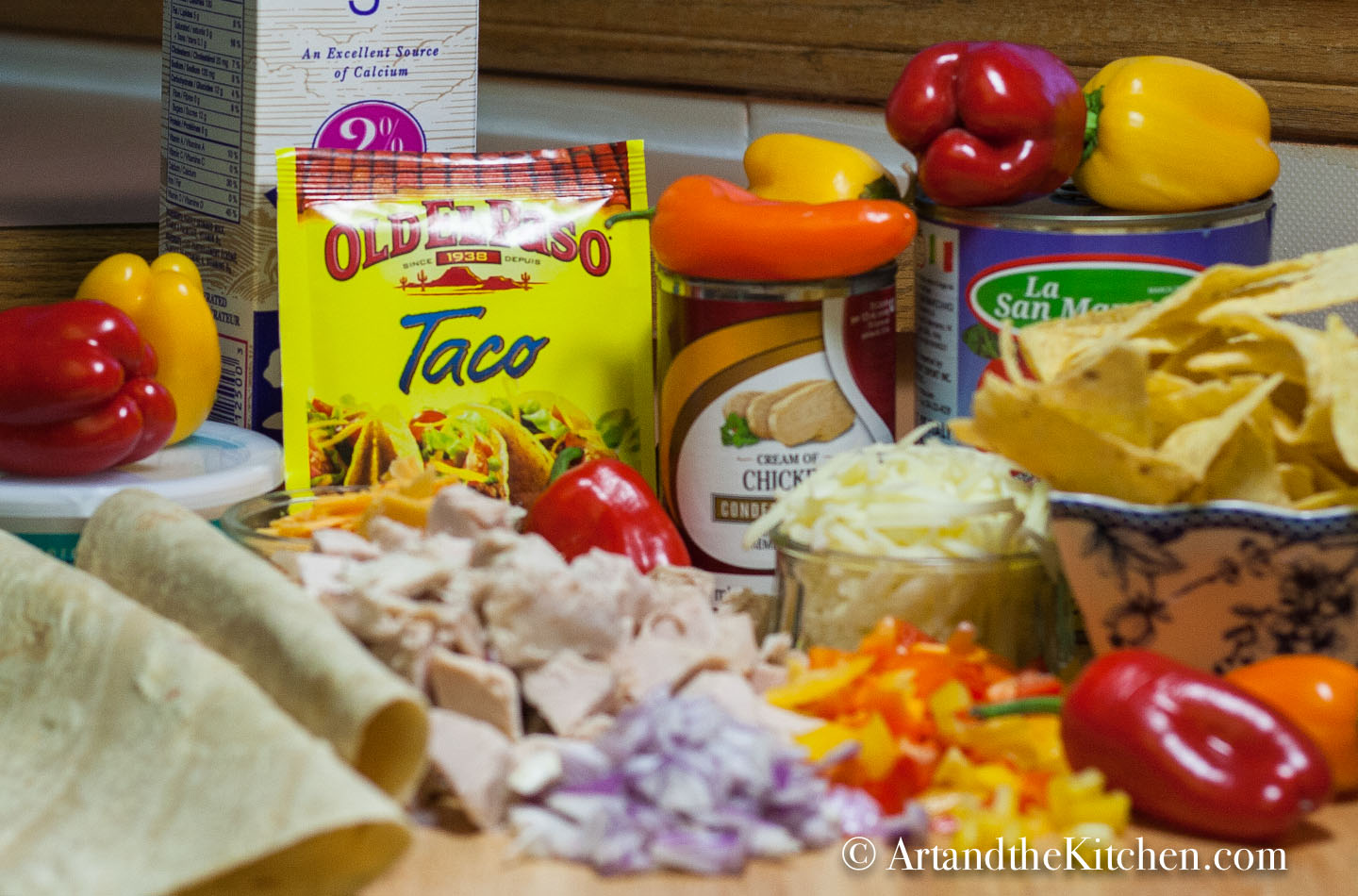 Ingredients for making Mexican turkey casserole. Chopped vegetables, tortillas , spice mix and more.