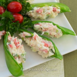 Plate of snow peas stuffed with crab filling.