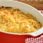 Tuna casserole topped with Panko crumb mix in red oval baking dish.