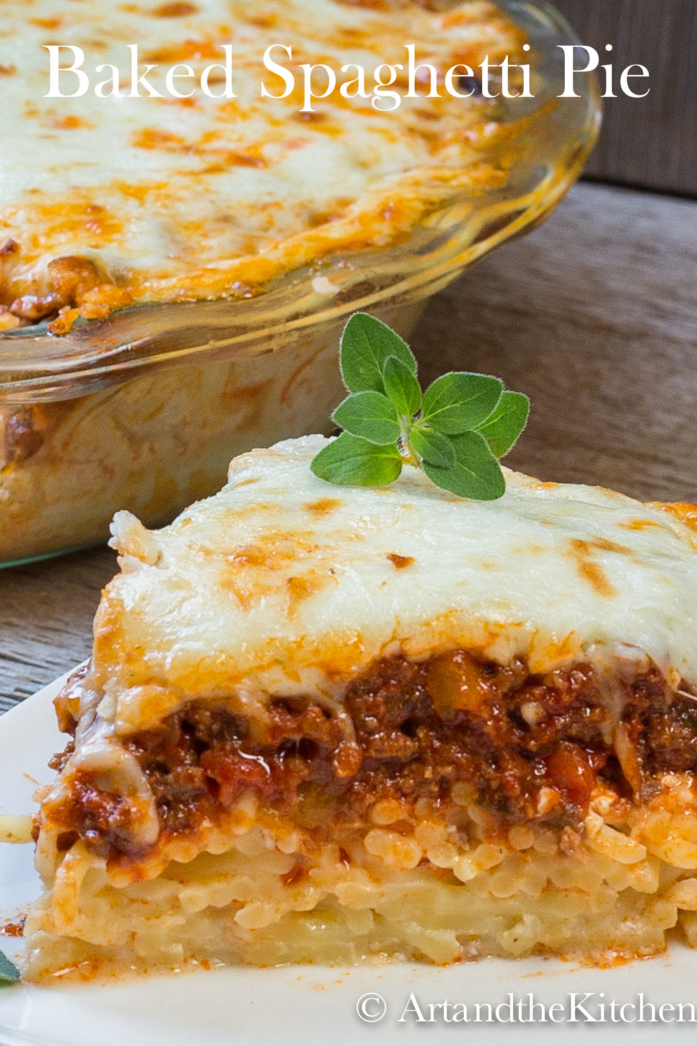 This Baked Spaghetti Pie recipe is put together with a cheesy spaghetti crust, delicious layers of meat sauce and cottage cheese topped with melted cheese. You can make it ahead of time, so its perfect for those busy days. via @artandthekitch