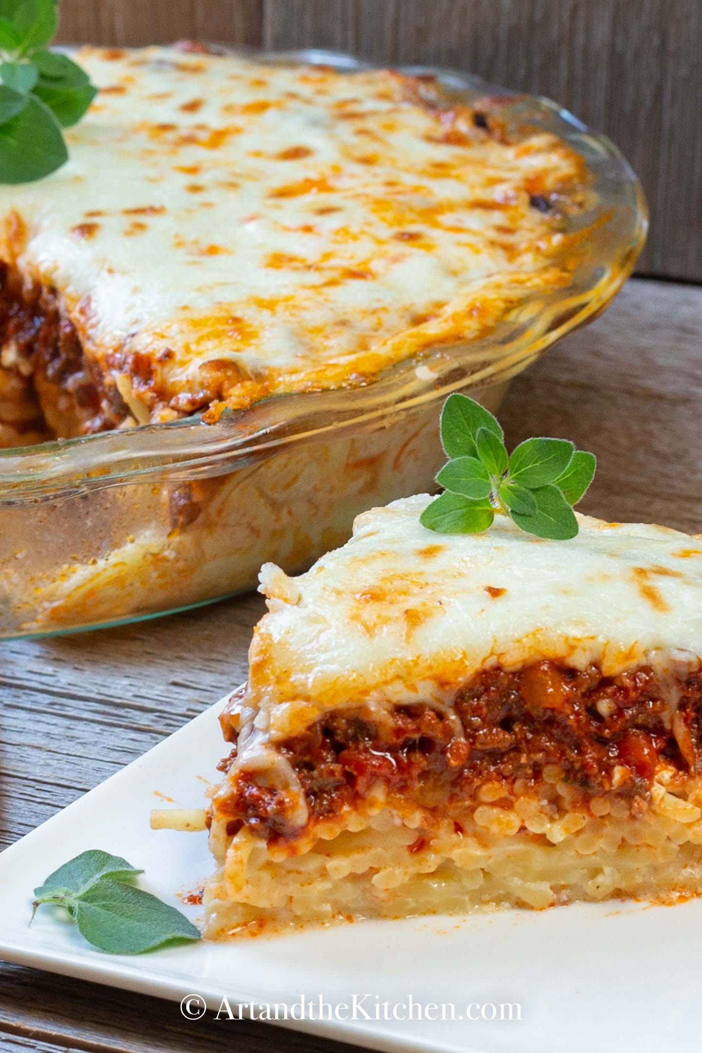 Dinner pie made with layers of spaghetti, meat sauce, topped with melted cheese.