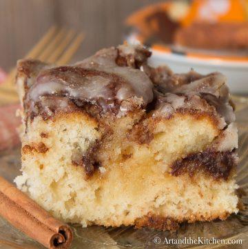Slice of cake with cinnamon butter swirls.