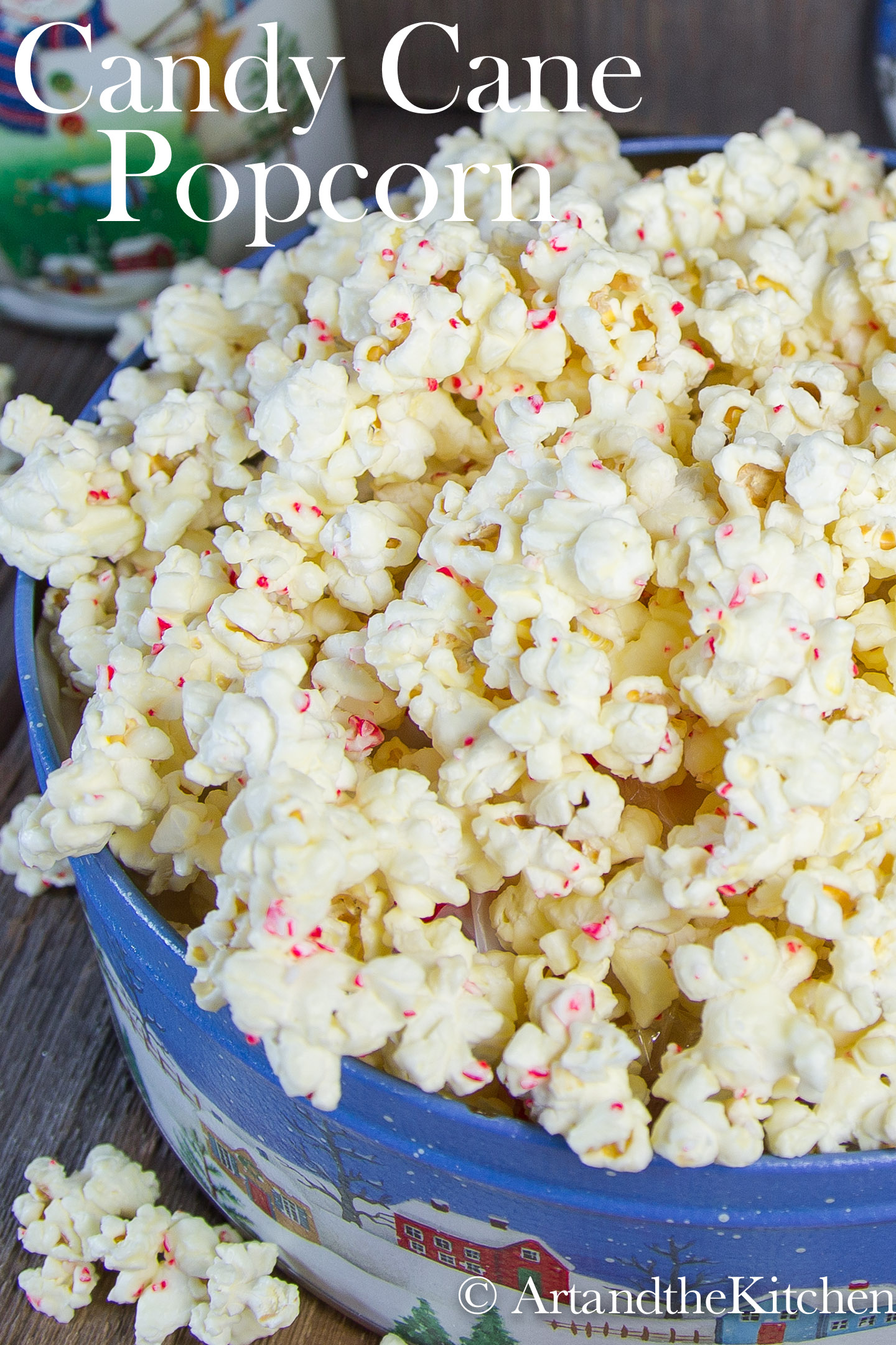White Chocolate Candy cane popcorn is a must make holiday treat. It is so easy to make, popcorn coated in white chocolate and bits of candy cane. This addictive snack makes a great gourmet food gift. via @artandthekitch