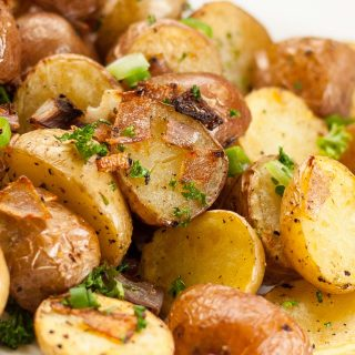 Pile of crispy roasted potatoes with onions.