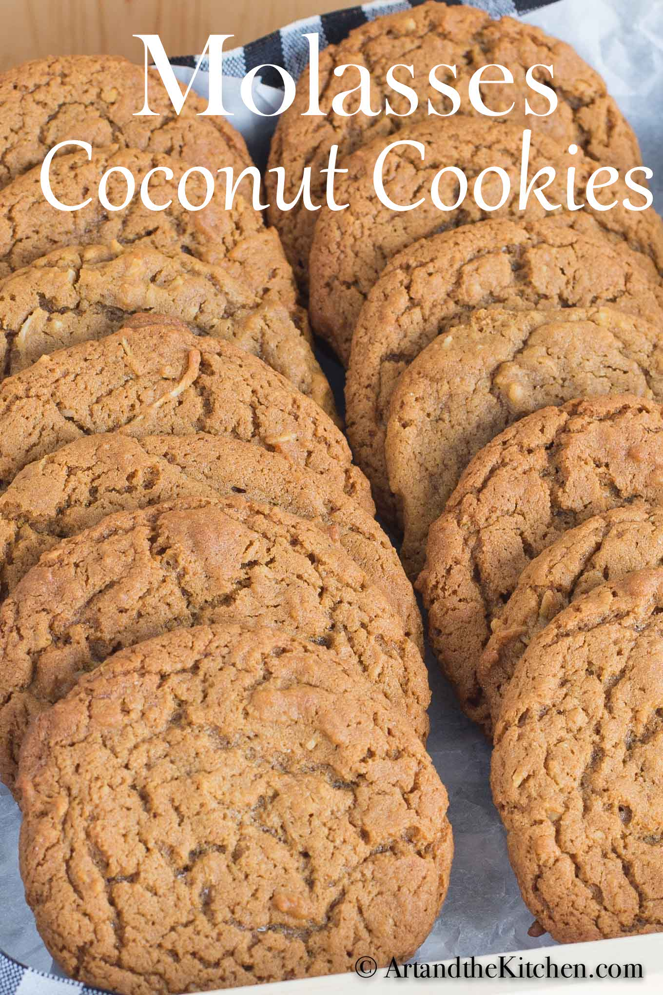 Soft and chewy molasses coconut cookies are perfectly spiced with the bold flavors of ginger, nutmeg, cloves and molasses. The addition of coconut to these old-fashioned molasses cookies make them extra chewy inside, yet crisp on the outside! via @artandthekitch