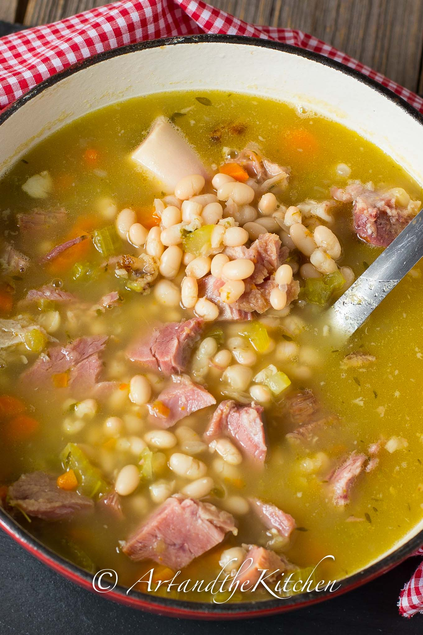 Pot of ham and bean soup with ham bone.