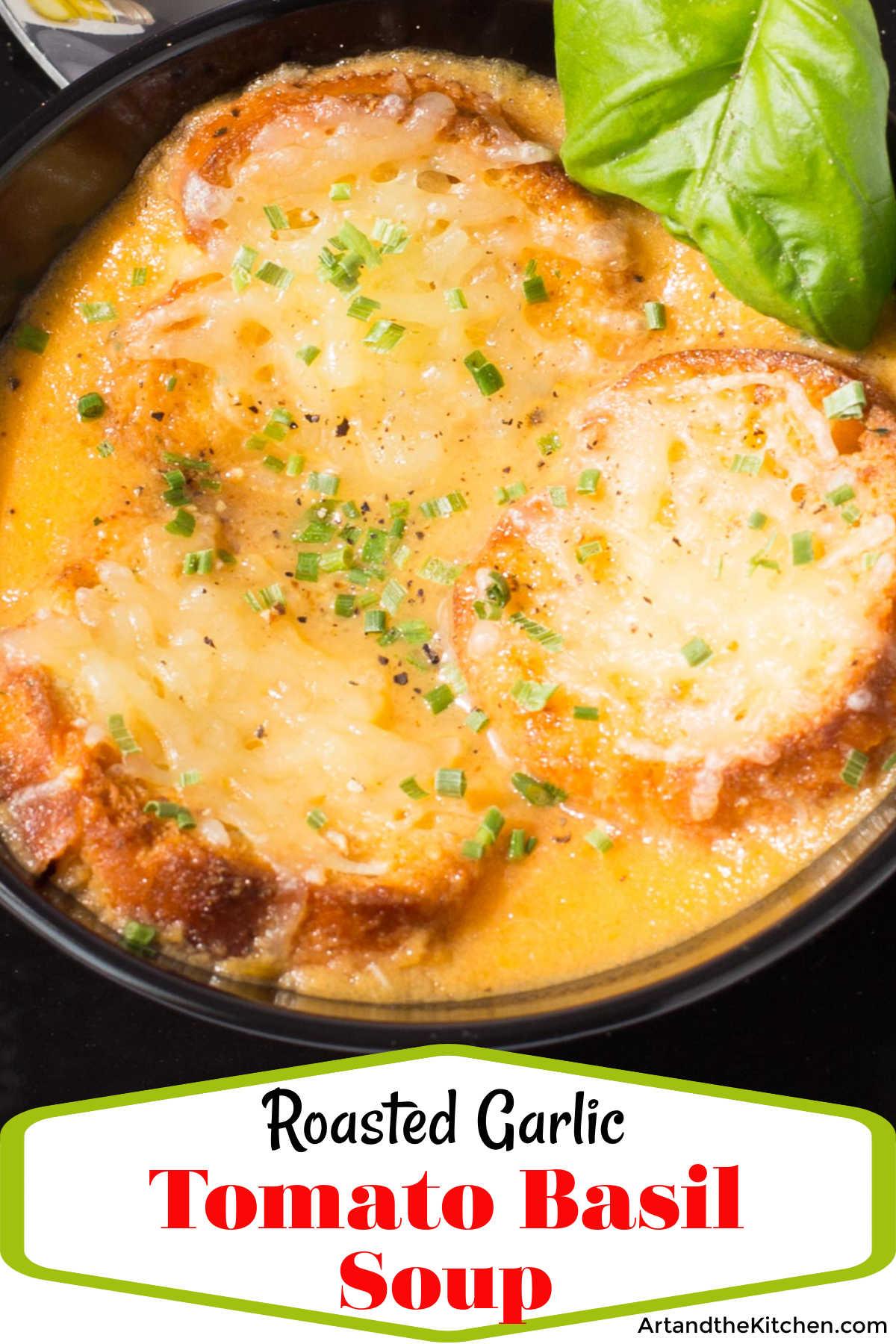 Tomato Soup with Roasted Garlic and Basil is super flavorful! It is made with roasted garlic, fresh basil and fresh, ripe tomatoes. via @artandthekitch