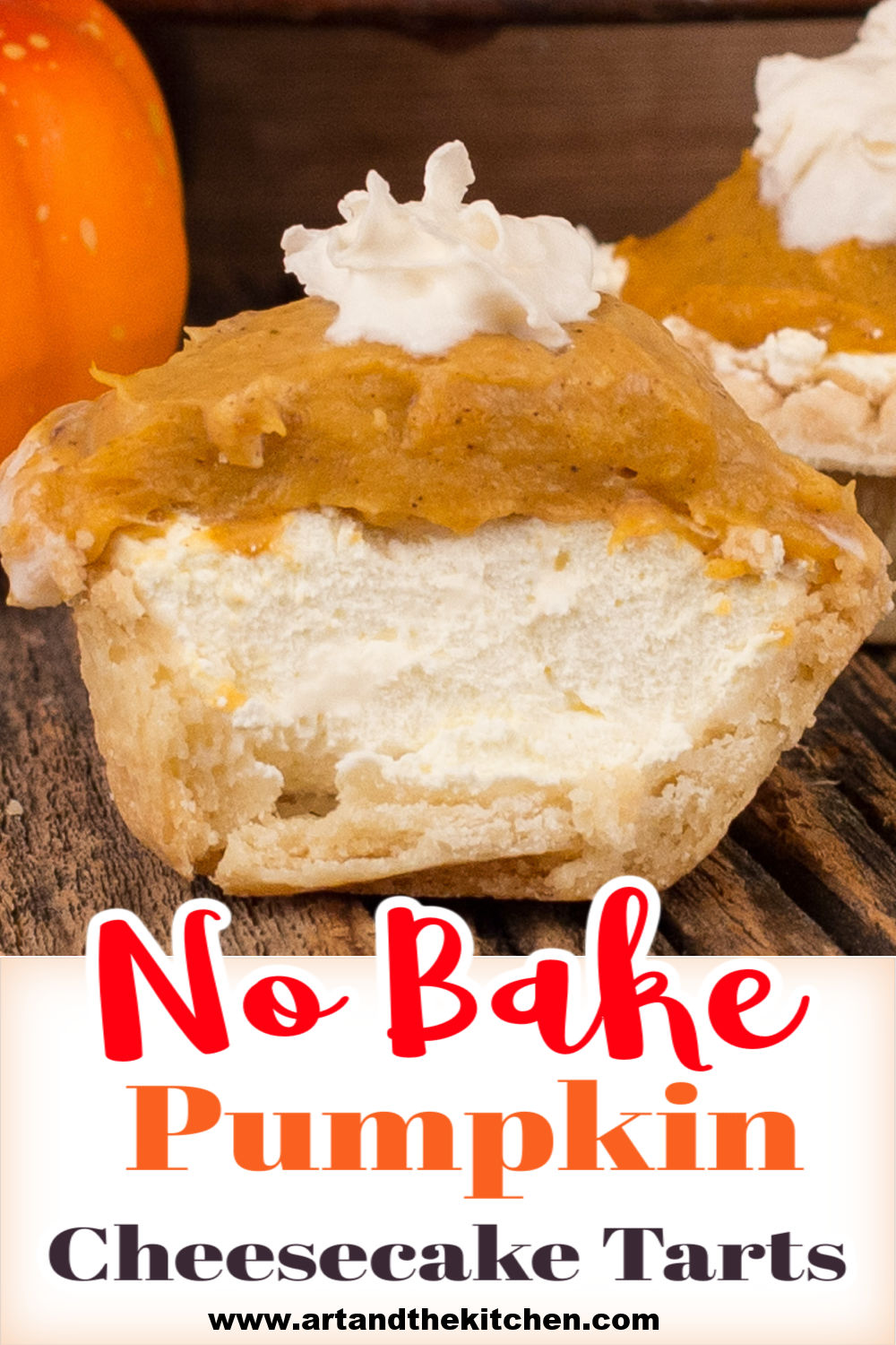 Pumpkin Cheesecake Tarts have delicious layers of cream cheese, pumpkin filling, in a flaky tart shell. Topped with a dollop of whipped cream. via @artandthekitch