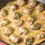 pan seared meatballs with rich creamy sauce in cast iron pan