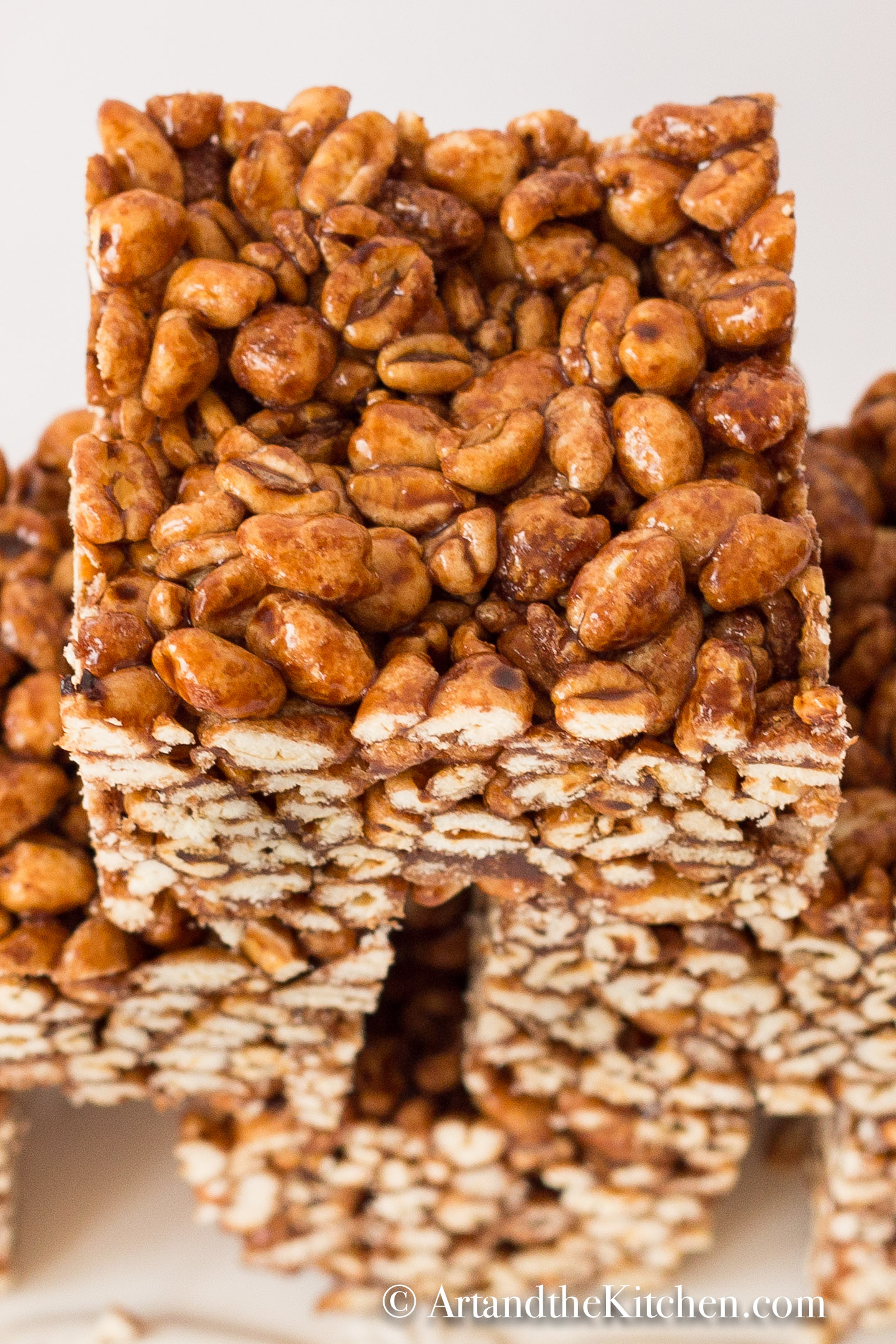 Puffed Wheat Squares are an easy to make treat. A great no bake square that is chewy and gooey. via @artandthekitch