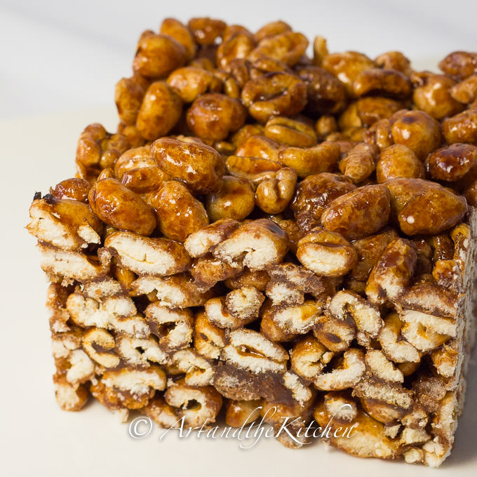Single piece of square make with puffed wheat and gooey syrup mixture.