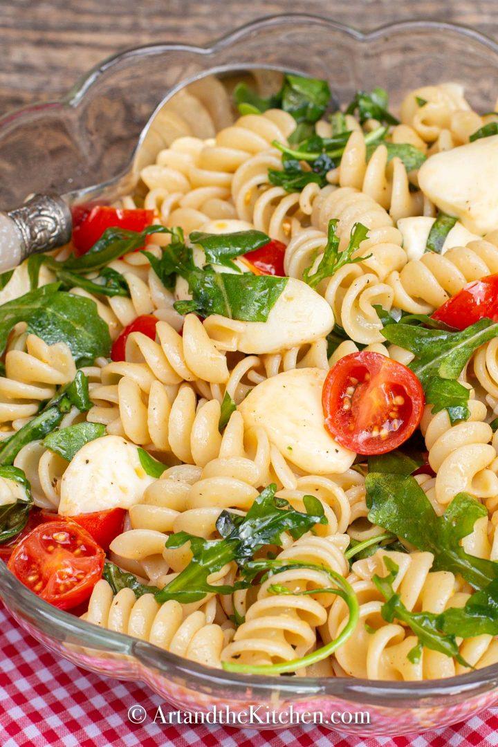 Rotini pasta with bocconcini, tomatoes and arugula.