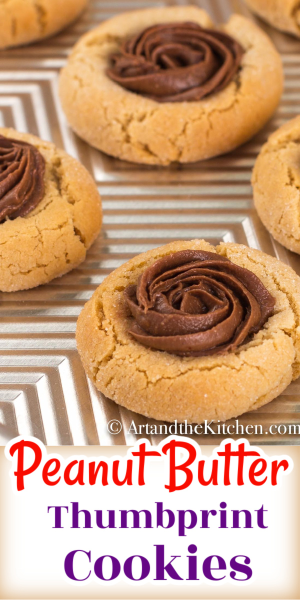 Peanut Butter Cookies are a classic, and this recipe is easy to make with a soft cookie inside, crisp on the outside! Perfect for making thumbprint cookies. via @artandthekitch