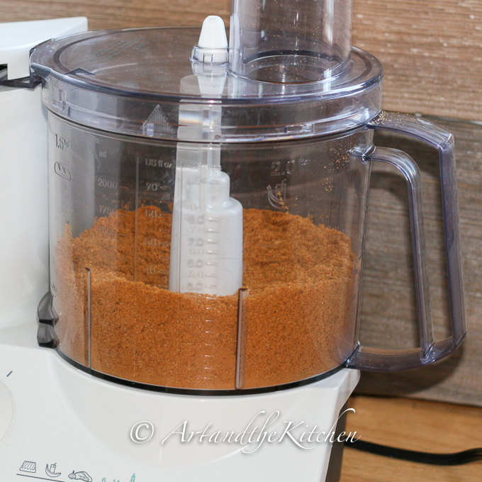 Food processor filled with ground gingersnaps.