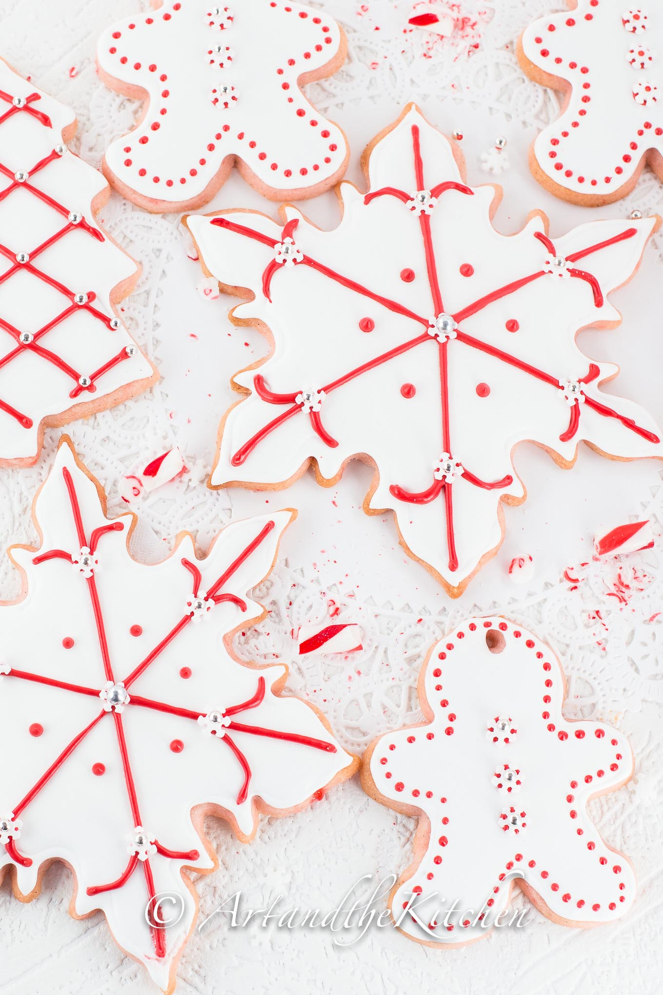 Tray of sugar cookies decorated with white and red royal icing.