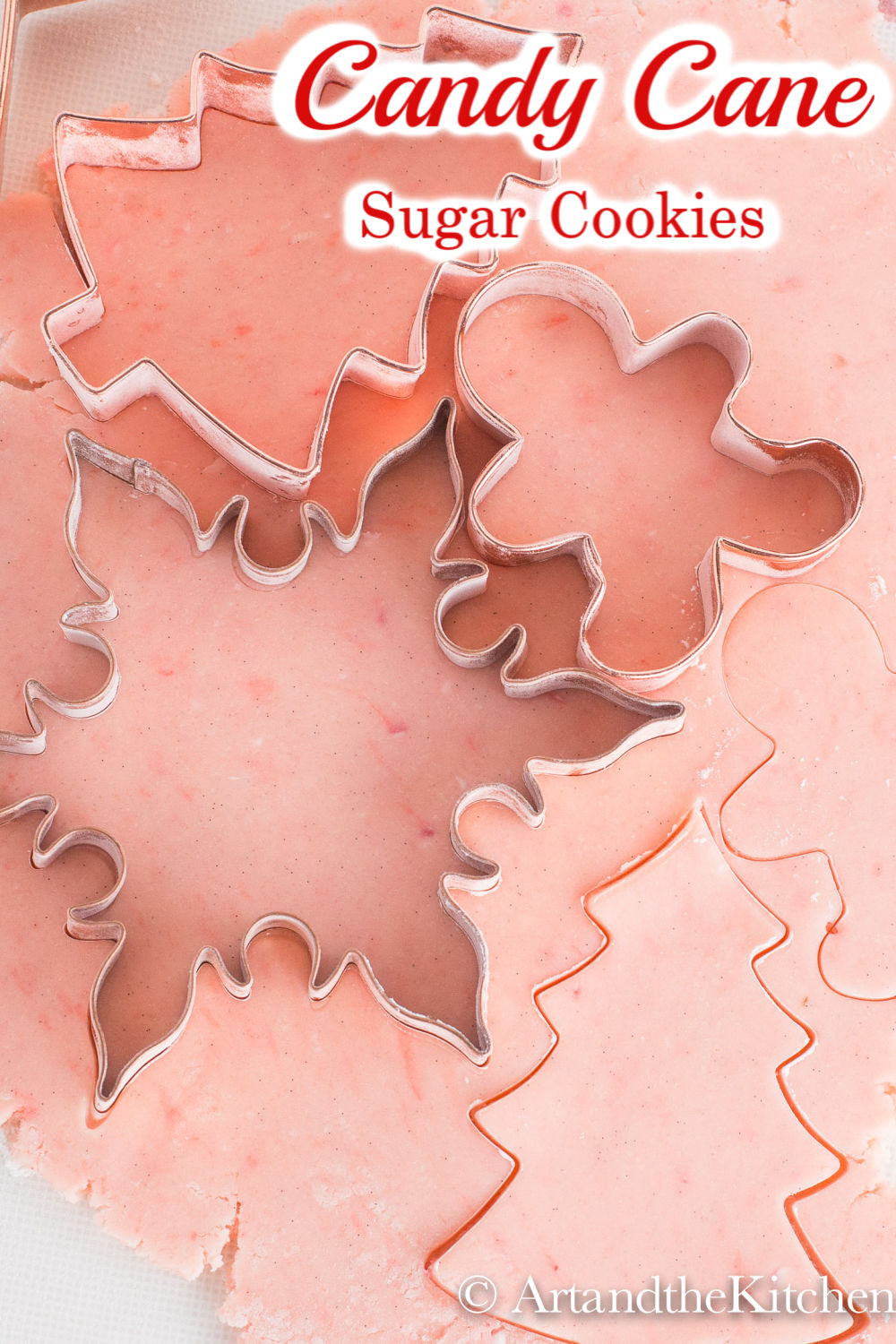 Amazing tasting Candy Cane Sugar Cookies. The perfect recipe for making decorative cut out cookies. via @artandthekitch