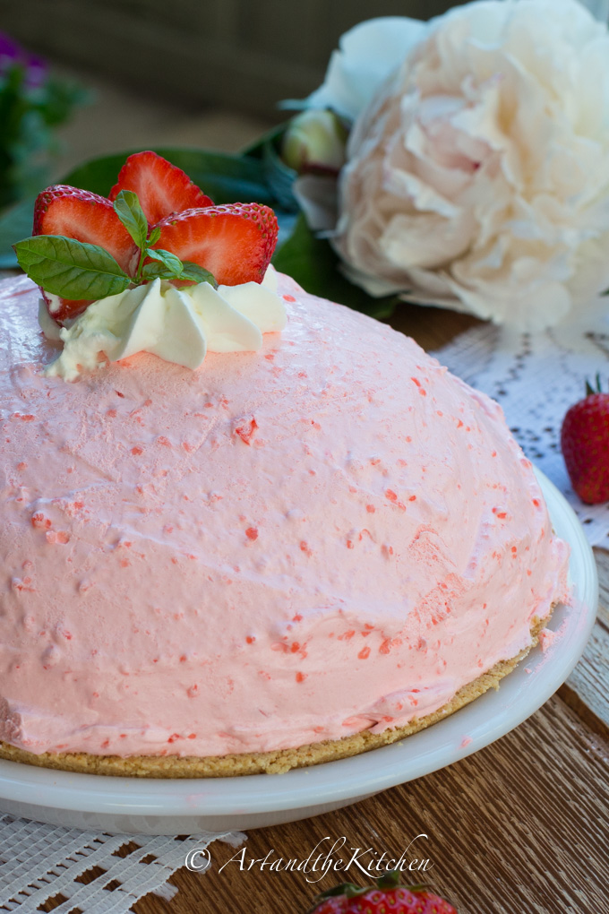 Tall no-bake strawberry pie with fresh strawberries.