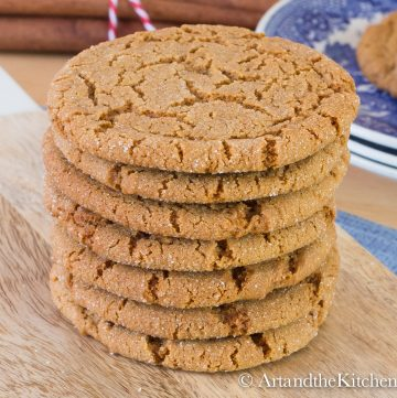 Stack of crispy ginger cookies on wood board