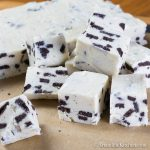 Cubes of fudge made with white chocolate and Oreo cookie pieces.