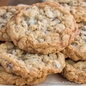 Wooden plate filled with homemade chocolate chip cookies