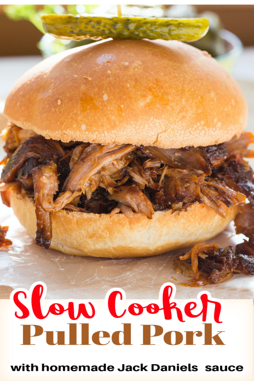 Slow Cooker Pulled Pork is great to feed a crowd. Tender and delicious with  homemade Jack Daniels BBQ sauce. via @artandthekitch