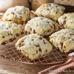 Cinnamon and raisin scones on a copper cooling rack