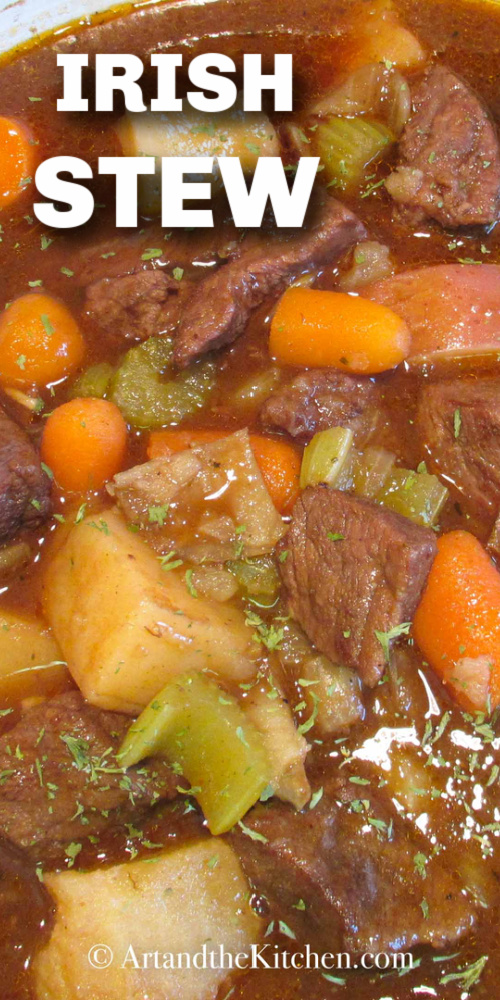 This Irish Stew recipe is incredible. Simmered in a rich sauce of Guinness beer and red wine. Beef that is fall-apart tender! via @artandthekitch