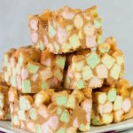stack of sweet squares made with colorful mini marshmallows, peanut butter and butterscotch chips.