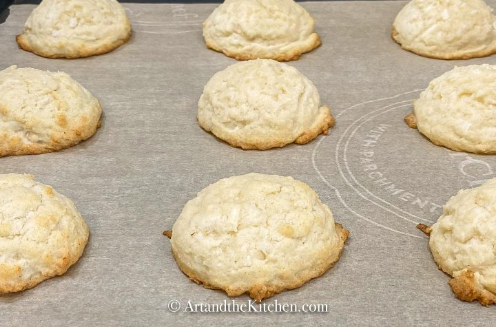 Freshly baked cookies on parchment lined baking sheet.