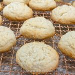 Copper baking rack filled with coconut sugar cookies.